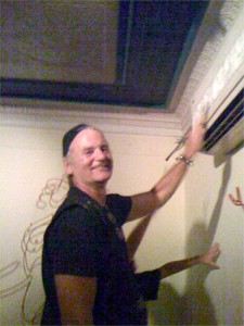 Bill Murray cleaning an AC unit at a restaurant in Martha's Vineyard